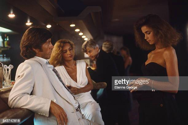 French actors Bernard Giraudeau Caroline Cellier Jacques Perrin and Valerie Kaprisky on the set of the film 'L'Annee des meduses' directed by English...
