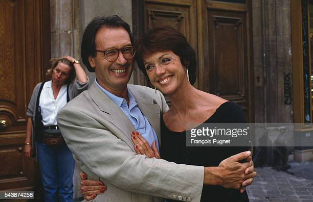"""French actors Bernard Le Coq and Anny Duperey on the set of the television show """"Une famille formidable"""", directed by Joel Santoni."""