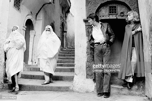 French actors Caroline Cellier and Marc Porel in the Casbah while on the set of the film Les Aveux Les Plus Doux directed by Edouard Molinaro