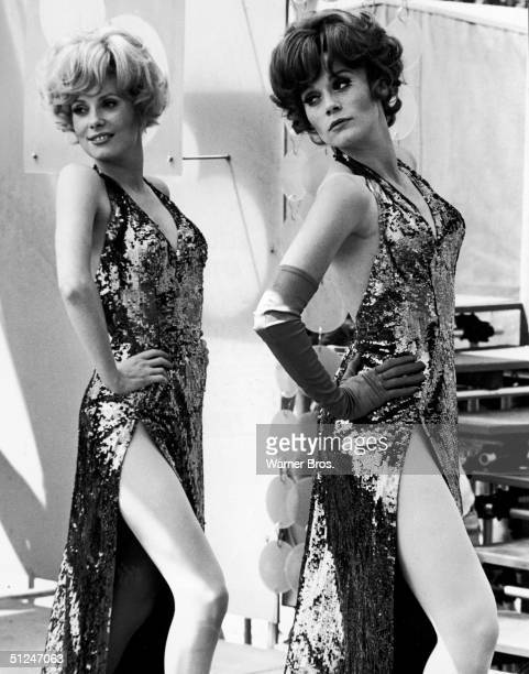 1967 French actors Catherine Deneuve and her sister Francoise Dorleac perform a musical number wearing slit gowns in a scene from the film Les...