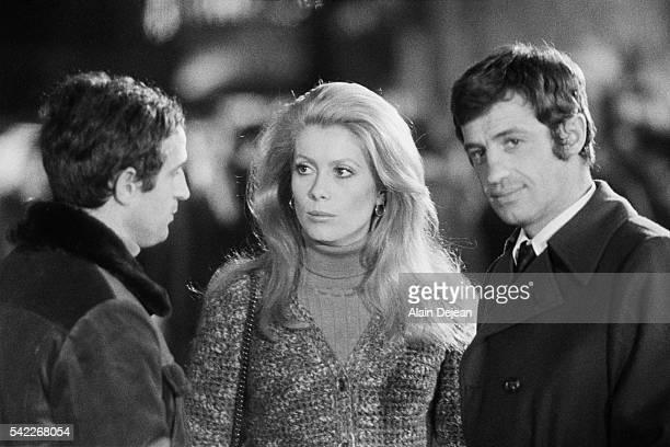 French actors Catherine Deneuve and JeanPaul Belmondo and director Francois Truffaut on the set of the 1969 French film La Sirene du Mississipi