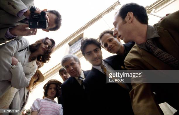 French actors Charles Berling and Yvan Attal with cast and crew on the set of the film Love etc directed by Marion Vernoux