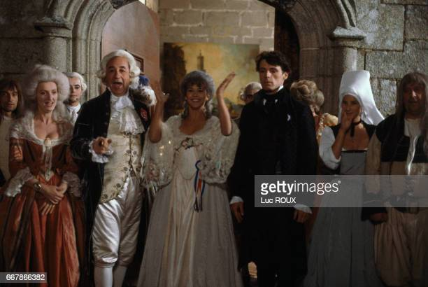 French actors Charlotte de Turckheim Philippe Noiret Sophie Marceau Lambert Wilson and Isabelle Gelinas on the set of the film Chouans directed by...