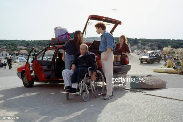 French actors Charlotte Gainsbourg, Jean Carmet, Thierry Fremont, and Annie Girardot on the set of Merci la Vie, written and directed by Bertrand...