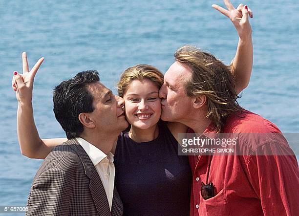 French actors Christian Clavier Gerard Depardieu and model Laeticia Casta pose for photographers for the promotion of their film Asterix and Obelix...