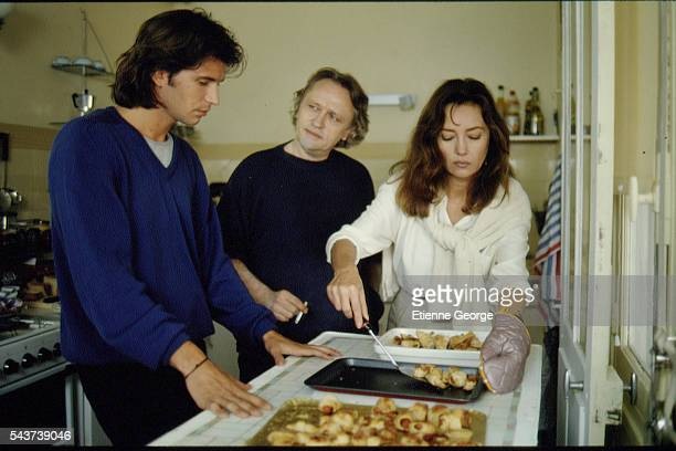 French actors Christopher Thompson Niels Arestrup and Caroline Cellier on the set of the film Délit mineur directed by French director Francis Girod