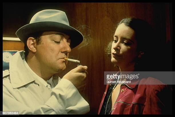 French actors Coluche and Dominique Lavanant on the set of Inspecteur la Bavure written and directed by Claude Zidi