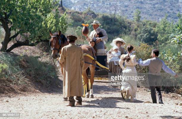 French actors Didier Pain and Julien Ciamaca Nathalie Roussel and Philippe Caubere on the set of the film La Gloire de Mon Pere directed by Yves...