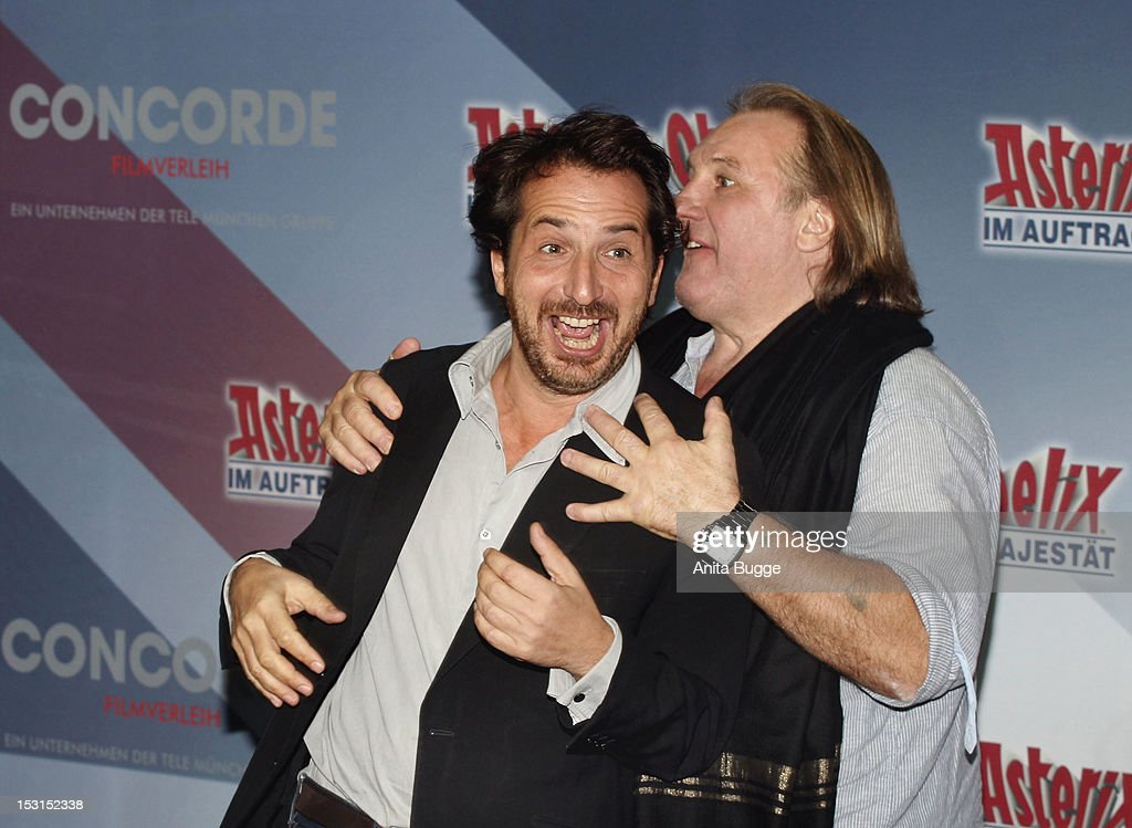 French actors Edouard Baer (L) and Gerard Depardieu attend the 'Asterix & Obelix God Save Britannia' photocall at Hotel de Rome on October 1, 2012 in Berlin, Germany.
