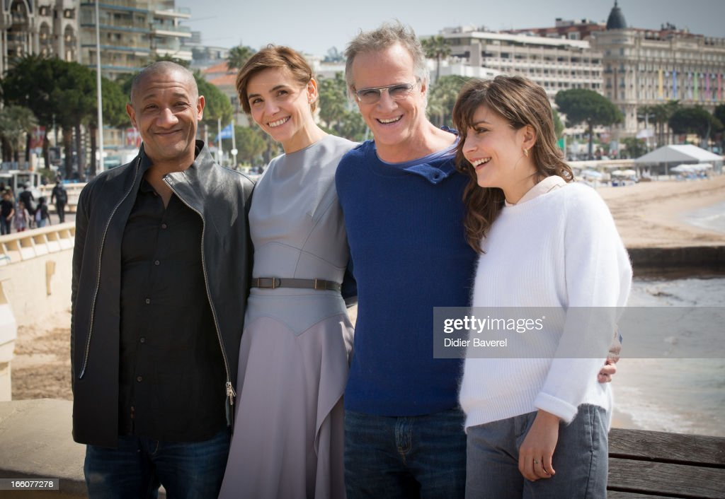 French actors Edouard Montoute, Christophe Lambert, actress Clotilde Courau (L) and actress Flore Bonaventura (R) pose during a photocall for the tv series'La Source' at MIP TV 2013 on April 8, 2013 in Cannes, France.
