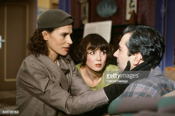 French actors Fanny Ardant Sabine Azéma and Pierre Arditi on the set of Melo directed by Alain Resnais based on the Henri Bernstein play Sabine Azéma...