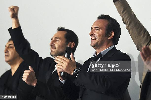 French actors Gilles Lellouche and Jean Dujardin attend the premiere of the film La French at the Prado cinema in Marseille on November 22 2014...