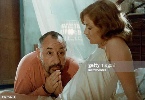 """French actors Isabelle Huppert and Philippe Noiret on the movie set of """"Coup de torchon"""" , directed by Bertrand Tavernier."""