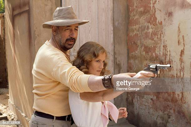 French actors Isabelle Huppert and Philippe Noiret on the movie set of 'Coup de torchon' directed by Bertrand Tavernier