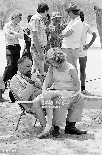 French actors Isabelle Huppert and Philippe Noiret on the set of the film 'Coup de Torchon' directed by Bertrand Tavernier