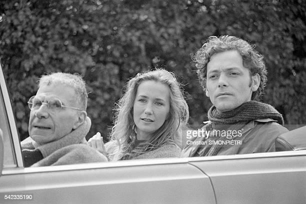 French actors Jacques Dufilho Brigitte Fossey and Patrick Dewaere on the set of the film Un Mauvais Fils directed by Claude Sautet