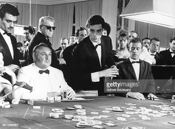 French actors Jean Gabin and Alain Delon on the set of Melodie en Soussol directed by Henri Verneuil
