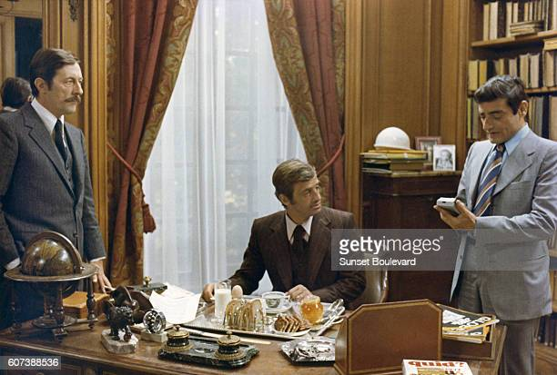 French actors Jean Paul Belmondo Jean Rochefort and Charles Denner on the set of L'Heritier written and directed by Philippe Labro