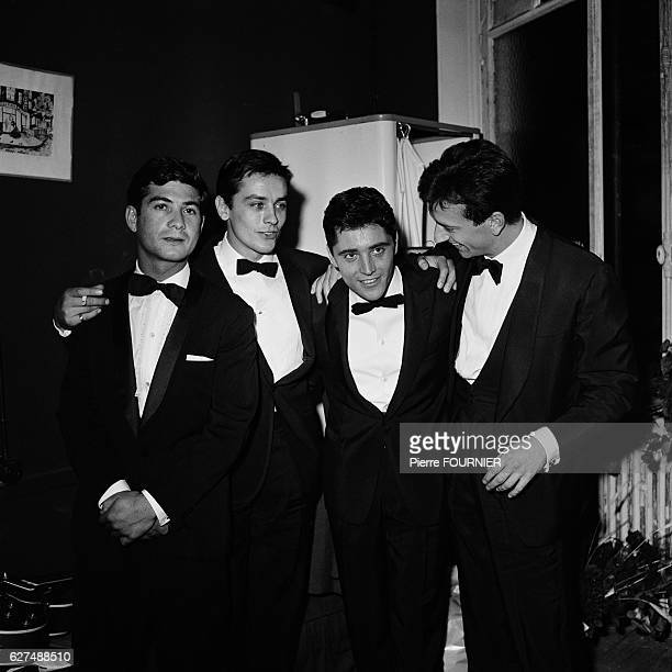 French actors JeanClaude Brialy Alain Delon and Jean Pierre Cassel congratulate singer and guitarist Sacha Distel in his dressingroom of the ABC...