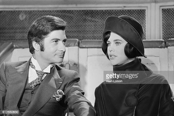 French actors JeanClaude Brialy and Sylvie Fennec on the set of Le Bal du Comte d'Orgel written and directed by Marc Allégret