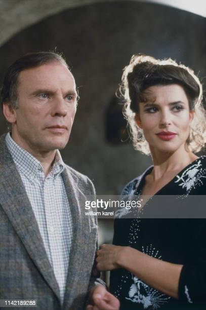 French actors JeanLouis Trintignant and Fanny Ardant on the set of Vivement Dimanche based on the novel The Long Saturday Night by Charles Williams...