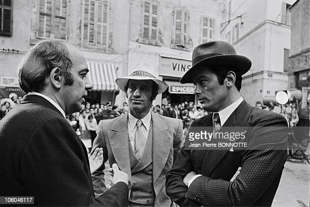 French actors JeanPaul Belmondo Alain Delon and director Jacques Deray on the set of gangster movie Borsalino in 1970 in Paris France