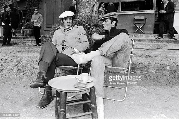 French actors JeanPaul Belmondo and Alain Delon on the set of gangster movie Borsalino directed by Jacques Deray in 1970 in Paris France