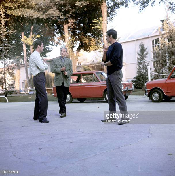 French actors JeanPaul Belmondo and Alain Delon with director Rene Clement on the set of Clement's movie Paris Bruletil