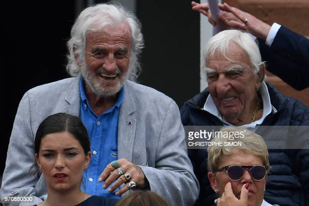 French actors JeanPaul Belmondo and Charles Gerard look on ahead of the men's singles final match between Spain's Rafael Nadal and Austria's Dominic...