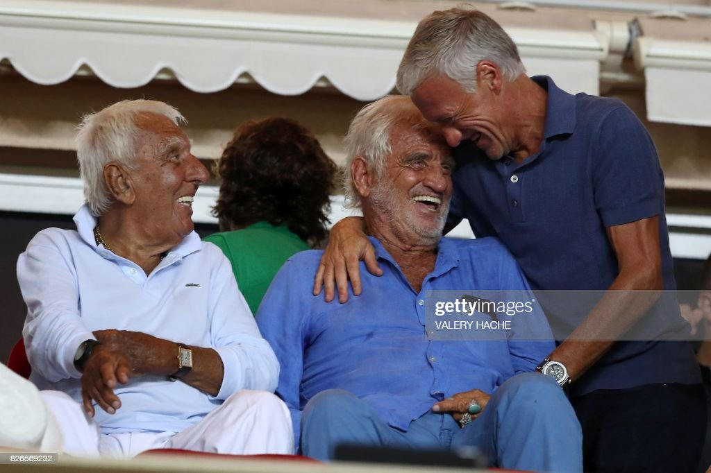 TOPSHOT - French actors Jean-Paul Belmondo (C) and Charles Gerard (L) talk with French national football team's coach Didier Deschamps (R) during the French football match Monaco vs Toulouse, on August 4, 2017 at the 'Louis II Stadium' in Monaco. /