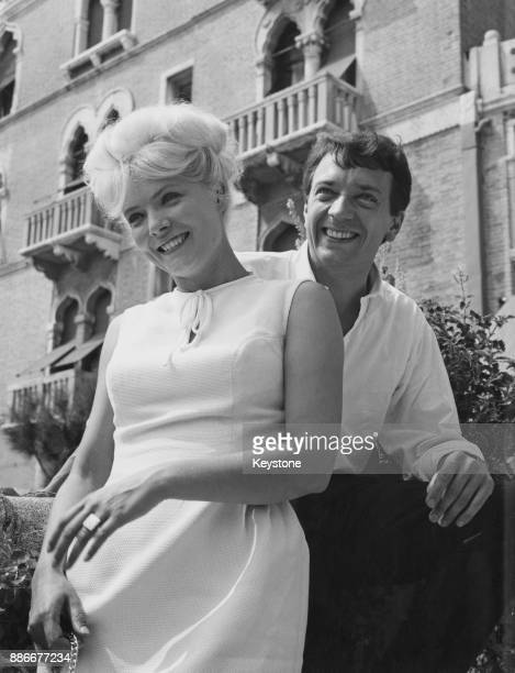 French actors JeanPierre Cassel and Corinne Marchand at the Venice Film Festival Italy circa 1962