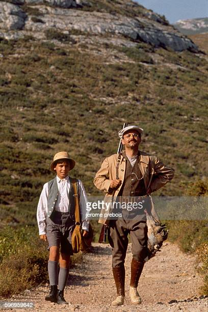 French actors Julien Ciamaca and Philippe Caubere on the set of the film La Gloire de Mon Pere directed by Yves Robert