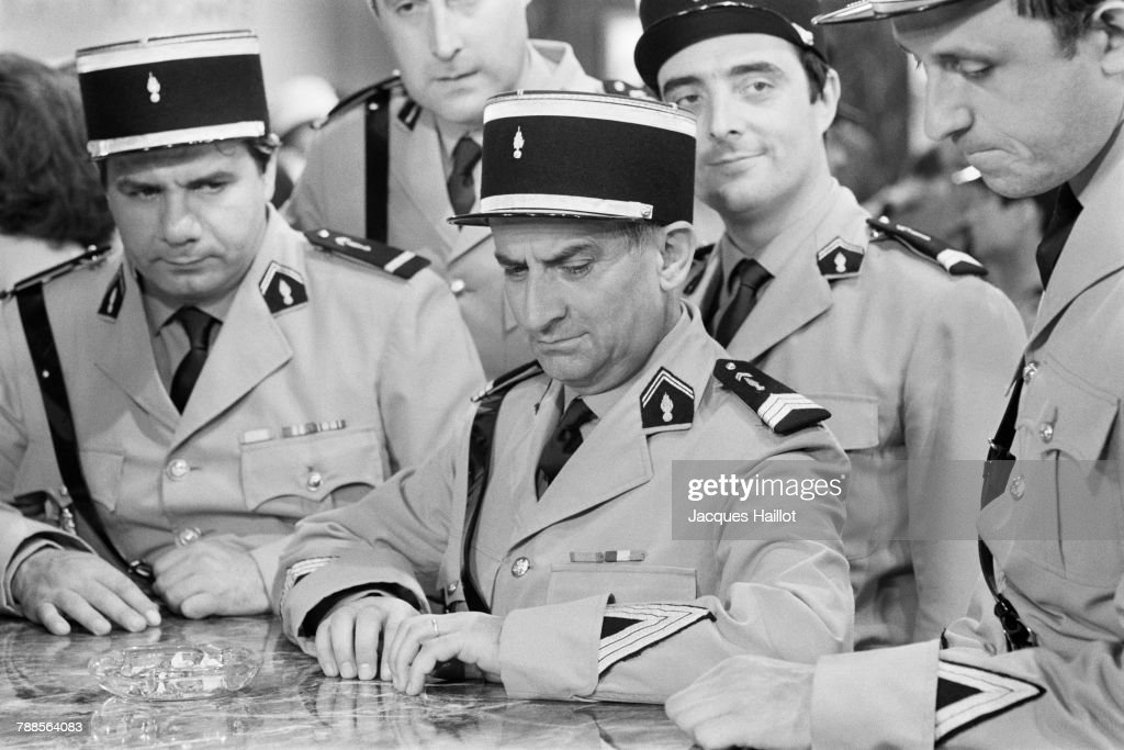 French actors Louis de Funes (C) Michel Galabru, Christian Marin, Michel Modo and Guy Grosso on the set of Le Gendarme a New York, directed and written by Jean Girault.