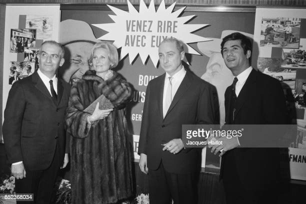 French actors Louis de Funès and JeanClaude Brialy and Michèle Morgan with husband director and screenwriter Gerard Oury during the premiere of his...