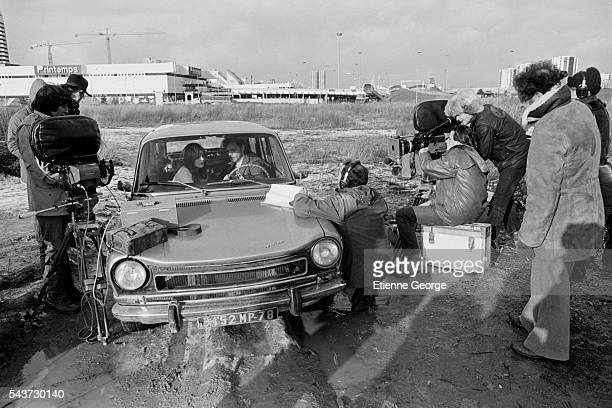 French actors Marie Trintignant and Patrick Dewaere seated in the car on the set of the film Serie Noire directed by Alain Corneau and based on...