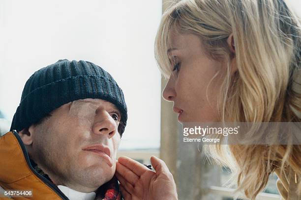 French actors Mathieu Amalric and Emmanuelle Seigner on the set of the film Le Scaphandre et le Papillon directed by American artist painter and...