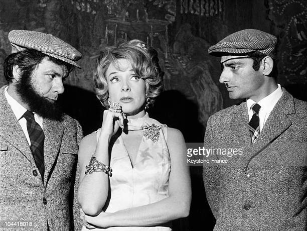 French actors Michel GALABRU Micheline PRESLE and Charles DENNER in a scene from the film LES PIEDS NICKELES in 1964