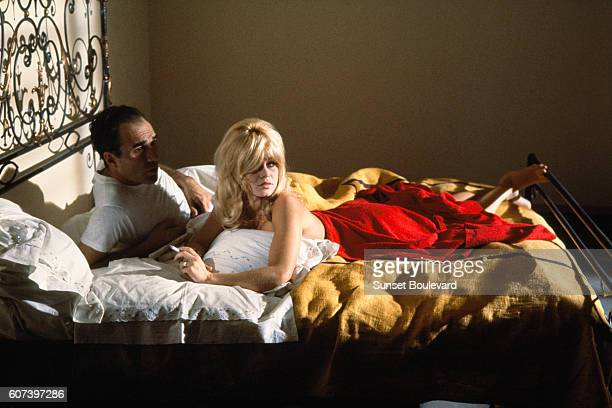 French actors Michel Piccoli and Brigitte Bardot on the set of Le Mepris , written and directed by Swiss-French director Jean-Luc Godard.