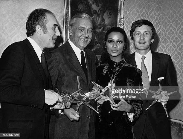 French actors Michel Piccoli Jacques Tati Cathy Rosier and Claude Rich with their crystal stars from the Film Academy on October 22 1968 in Paris...
