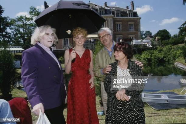 LR French actors Michel Piccoli Julie Gayet and producer Daniel Toscan du Plantier on the set of the film 'Les Cent et une nuits de Simon Cinéma'...