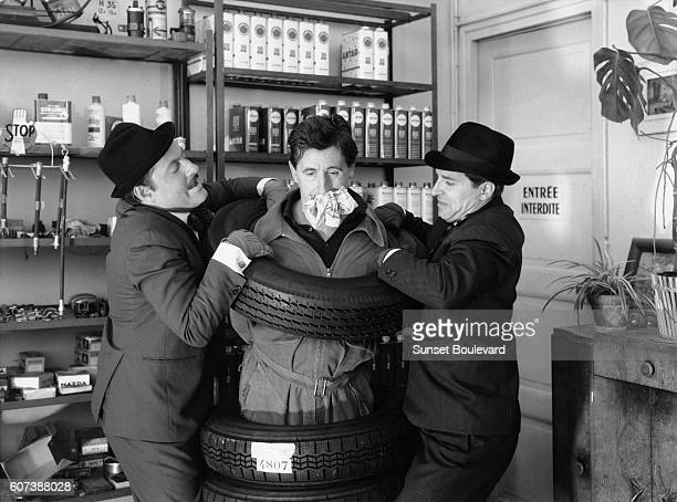 French actors Michel Serrault Jean Lefebvre and Jean Poiret on the set of La bonne occase directed by Michel Drach