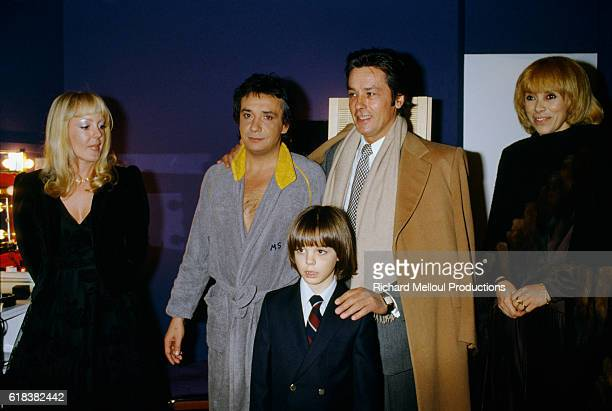 French actors Mireille Darc and Alain Delon backstage with singer Michel Sardou his wife Babette and their son Romain after his premiere at the...