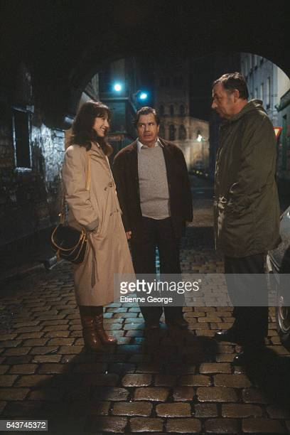"""French actors Nathalie Baye, Michel Galabru and Philippe Noiret on the set of the film """"Une semaine de vacances"""" , directed by Bertrand Tavernier."""