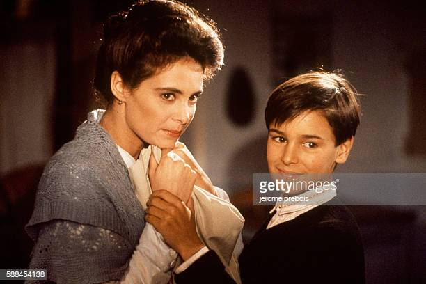 French actors Nathalie Roussel and Julien Ciamaca on the set of the film La Gloire de Mon Pere directed by Yves Robert