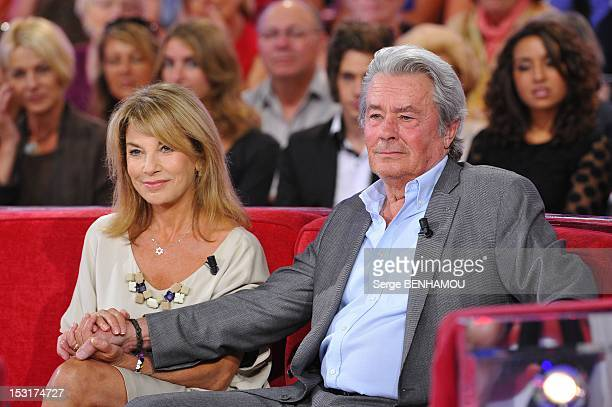 French actors Nicole Calfan and Alain Delon attend Vivement Dimanche Tv show on September 5 2012 in Paris France
