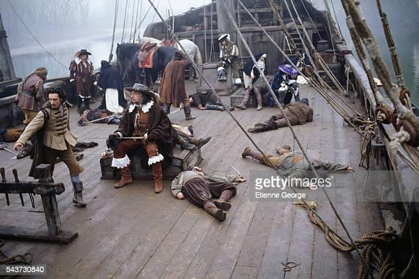French actors Nils Tavernier Philippe Noiret Raoul Billerey and JeanLuc Bideau on the set of the film La fille de d'Artagnan directed by French...