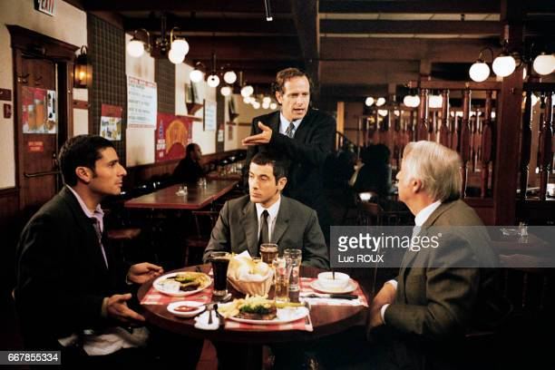 French actors Pascal Elbe Bruno Putzulu Charles Berling and Philippe Noiret on the set of the film Pere et Fils directed by Michel Boujenah
