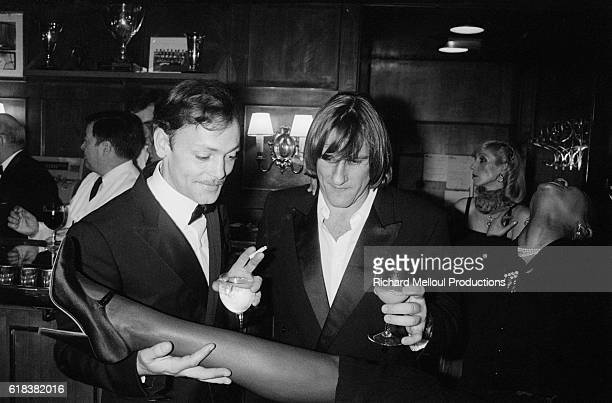 French actors Patrick Dewaere and Gerard Depardieu celebrate in a bar on the seventh night of the Cesar Awards drinking cocktails and admiring a...