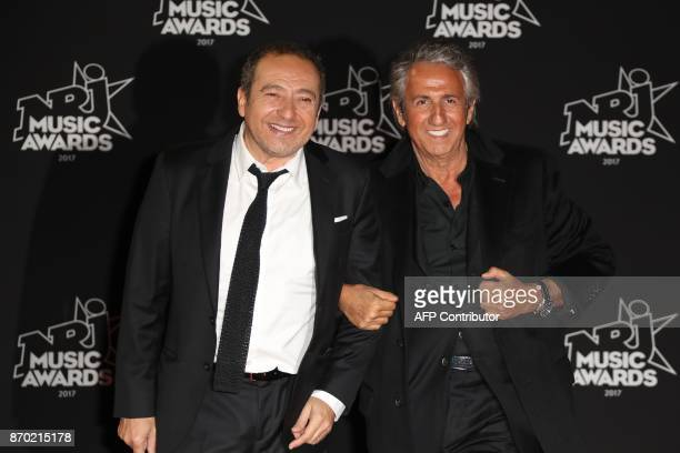 French actors Patrick Timsit and Richard Anconina pose upon their arrival to attend the 19th NRJ Music Awards at the Palais des Festivals in Cannes...