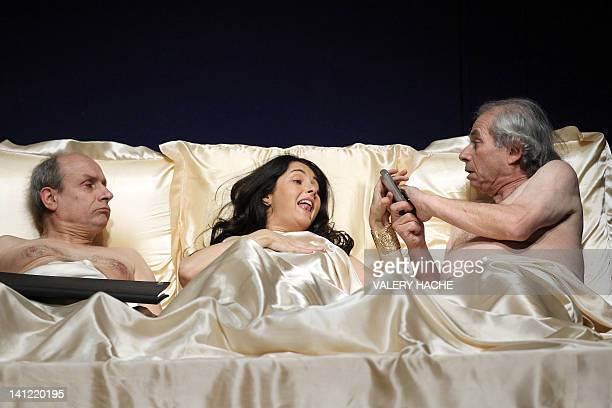 French actors Paul Charieras Christina Reali and Jacques Bellay perform during a rehearsal of Apres tout si ca marche a play written by US director...
